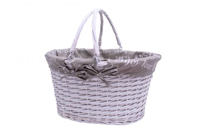 Einkaufskorb aus geweißter Weide mit grauer Stoffeinlage und Klapphenkel
